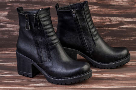 pair of new black leather boots
