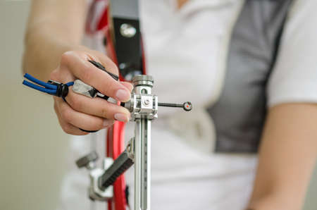 closeup female hand of an archer holding the bow Stok Fotoğraf