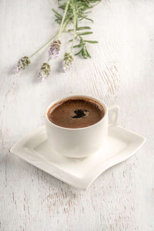 Turkish coffee on a wooden table decorated with lavender flowers Фото со стока