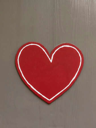 carved red heart on a wooden background for valentines day with copy space