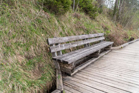 an empty old wooden bench at a park
