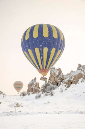 Cappadocia, Turkey - Feb. 19, 2012: Hot air balloon is getting ready for flight in Cappadocia. Cappadocia is one of the popular destinations and landmarks in Turkey. 新聞圖片