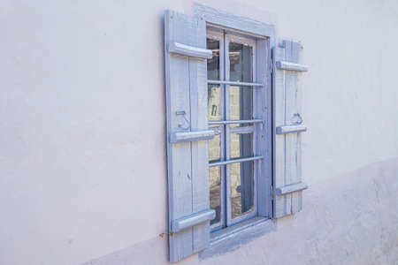 blue colored wooden window blinds of a house, outdoor Stock fotó - 138234224