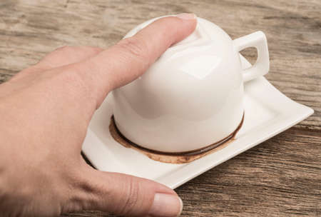 closeup of a female hand holding coffee cup in order to tell fortune
