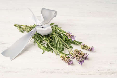 Levander flower bouquet on a wooden table with copy space