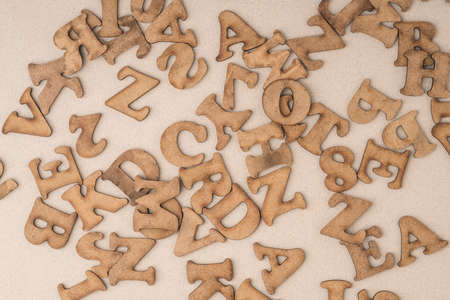 closeup of carved wooden alphabets as a background