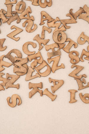 closeup carved wooden alphabets as a background with copy space