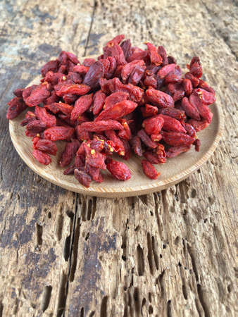 closeup goji berry fruits on a wooden table