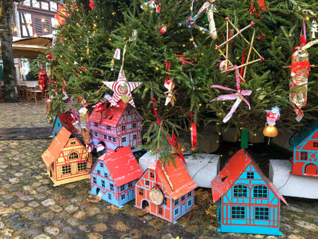 colorful houses and gifts under a christmas tree at street in France