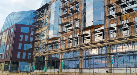 Construction of unfinished buildings, scaffolding, installation of windows