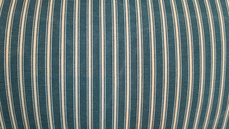 the footstool: Texture of a fabric of a pillow, sofa, bed, background. Close up, striped, blue and white vertical lines