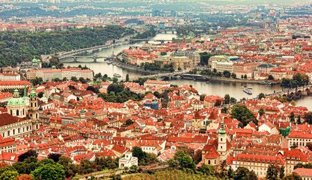 Beautiful panoramic aerial view of the Prague city from above with the old town and Vltava river. Amazing city landscape view. Vltava river from above
