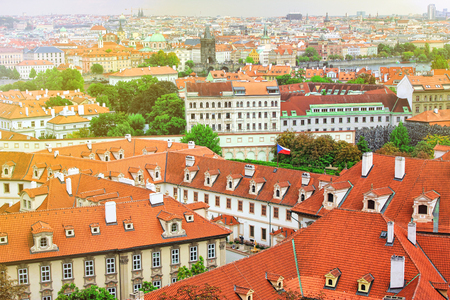 typical: Top view to red tile roofs of Prague city Czech republic. Typical Prague houses.
