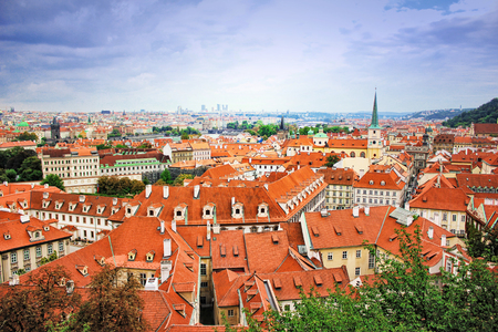 city park skyline: Top view to red tile roofs of Prague city Czech republic. Typical Prague houses. Wide angle panorama. Stock Photo