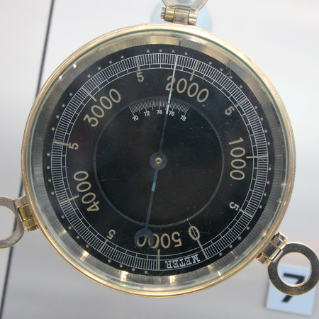 Old Vintage German Altimeter barometer with based on a white background, isolated, 0-5000 meter.