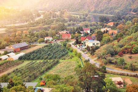 Beautiful sunset in suburb of Pague. Aerial view to romantic citiscape in Czech Republic, Central Europe