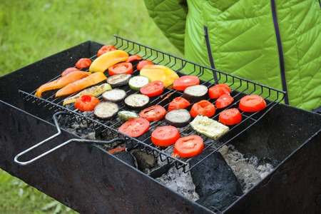 Grilled vegetable in a herb marinade on a grill, cooked in nature, top view.