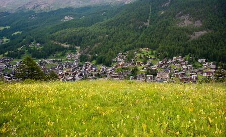 View of resort Zermatt on Alpine valley landscape, mountain, green meadow. Stock fotó