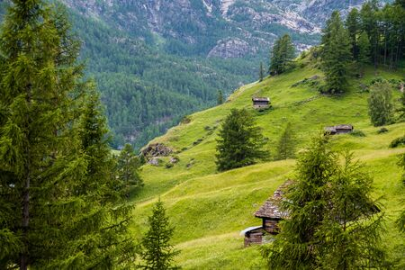 Amazing view in the mountains with old wooden barns among the meadow, Zermatt valley in Switzerland