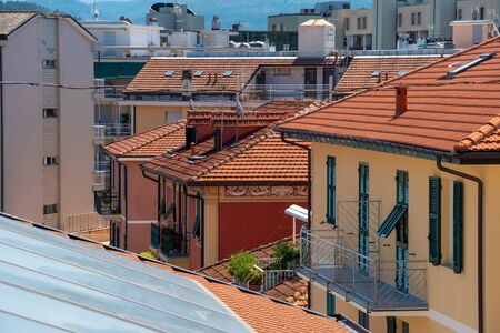 Houses with roofs covered with orange roof tiles. Italian street