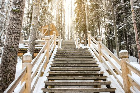 Beautiful winter landscape. A view of the stairs in the park or forest. Wooden staircase in the park in winter, around everything in the snow Stock fotó