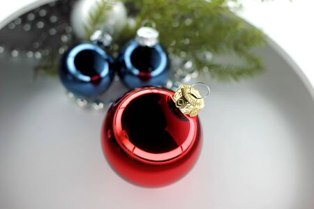 Christmas balls red and blue with beads on a white background. Stock fotó