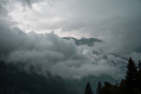 Gloomy dramatic mountain landscape. Atmospheric highland scenery in bad cloudy weather Stock Photo