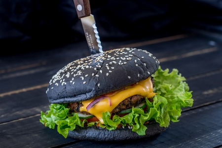 Black burger with meat