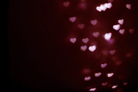 Blurred red heart shape bokeh background