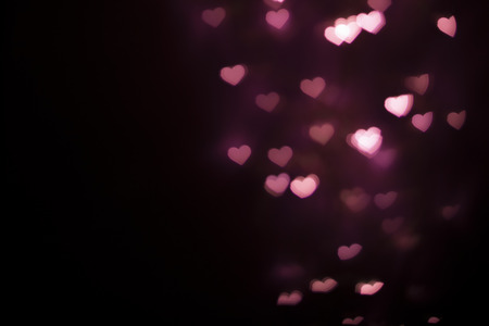 Blurred deep pink heart shape bokeh background Stock Photo