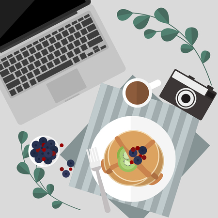 Morning pancake with berries and syrup and coffee serve on table next to laptop