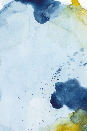 Abstract yellow and indigo blue watercolor paint on white paper background