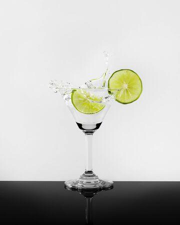 Lime martini splash photo shoot on black and white backgroud photo Фото со стока