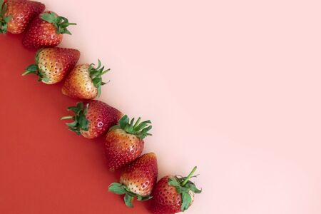 Minimal Strawberries on red and pink background photography