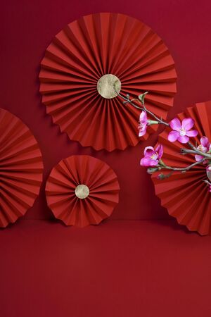 Lucky Chinese new year red background decoration with cherry blossom flower and paper fan photography Фото со стока