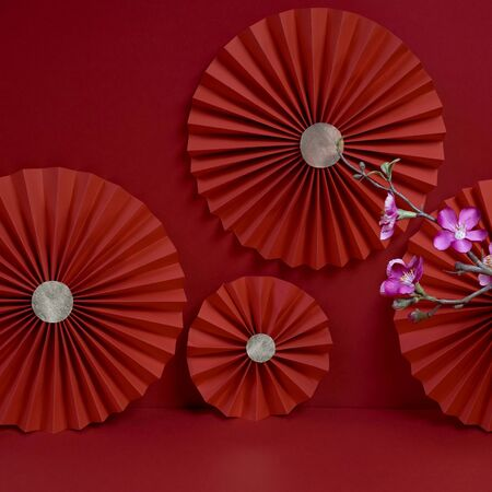 Lucky Chinese new year red  decoration with cherry blossom flower and paper fan photography