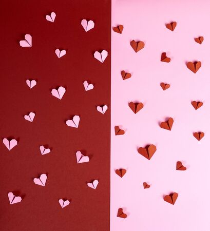 Red and pink heart shaped paper on paper background for Valentine's day poster photography