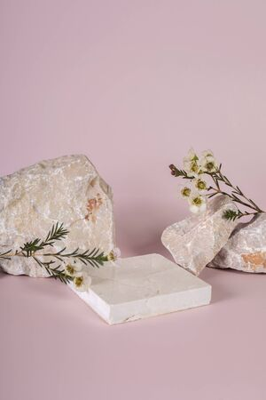 Pastel pink and white stone marble display set for product background decorate with white flower photography