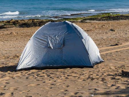along: Picnic tents along the coast.