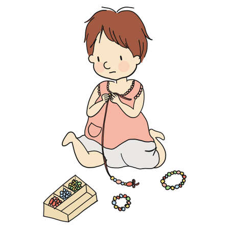 Little kid paling with colorful beads