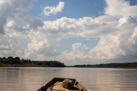 sailing the mekong river in an old boat, beautiful scenery of the asian river. Travel concept, adventure traveler