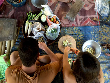 caucasian couple cooking thai food. Top view, copy space