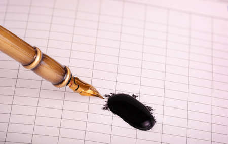 nib: old metal  pen, a notebook and the Blob