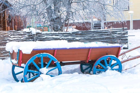 landscape mode: old cart in the snow Stock Photo