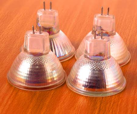 halogen: modern halogen light bulbs on a wooden table