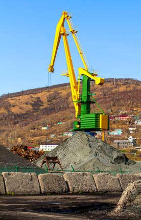 scrapyard: crane at the scrapyard in the seaport in Kamchatka