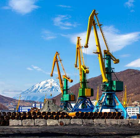 grabber: crane at the scrapyard in the seaport in Kamchatka