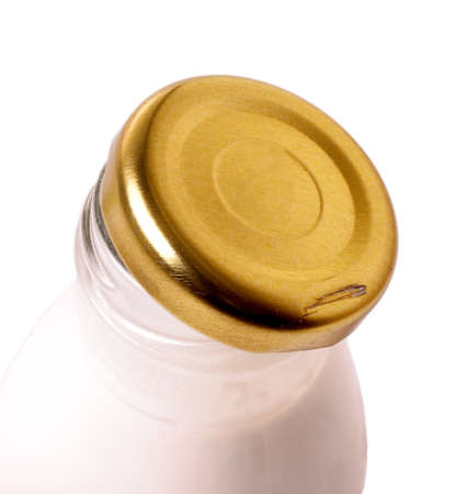 fermenting: opened milk glass bottle with metal lid on the white background