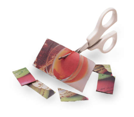 colored paper: baby white scissors cut colored paper on white Stock Photo