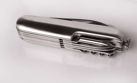 temperino: metal folding penknife cut out on white background